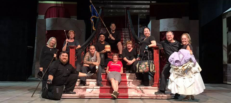 Hello Dolly Crew posing on the grand staircase